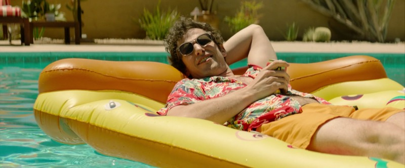 Andy Samberg in a pool floatie